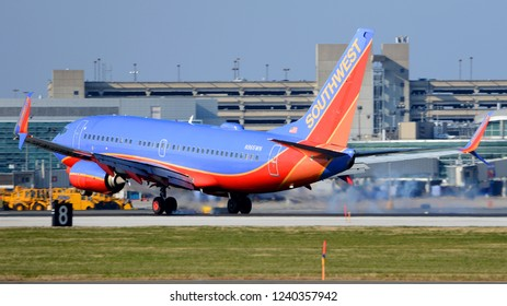 Philadelphia, PA - November 25th, 2018: A Southwest Airlines Boeing 737-7H4 Touching Down at Philadelphia International Airport in front of Terminal Buildings