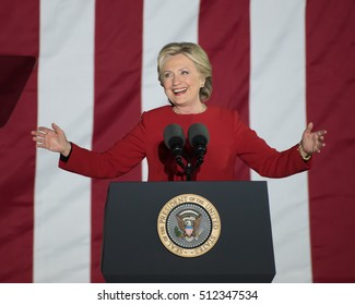 PHILADELPHIA, PA - NOVEMBER 7, 2016: Hillary Clinton smiling. The Democratic Presidential nominee gestures arms wide open at a campaign rally on the eve of the US election.