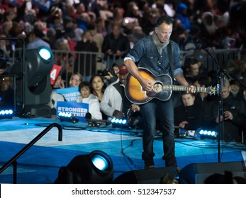 PHILADELPHIA, PA - NOVEMBER 7, 2016: Bruce Springsteen performs at a Hillary Clinton rally to a large crowd of supporters.