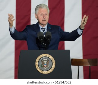 PHILADELPHIA, PA - NOVEMBER 7, 2016: Bill Clinton former US president gestures arms up as he delivers a speech at a campaign rally for Hillary Clinton the Democratic Presidential nominee.