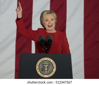 PHILADELPHIA, PA - NOVEMBER 7, 2016: Hillary Clinton pointing up. The Democratic Presidential nominee gestures smiling at a campaign rally on the eve of the US election.