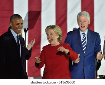 PHILADELPHIA, PA - NOVEMBER 7, 2016: Hillary Clinton laughs at the conclusion of her speech at a campaign rally on stage with President Obama and former President Bill Clinton.