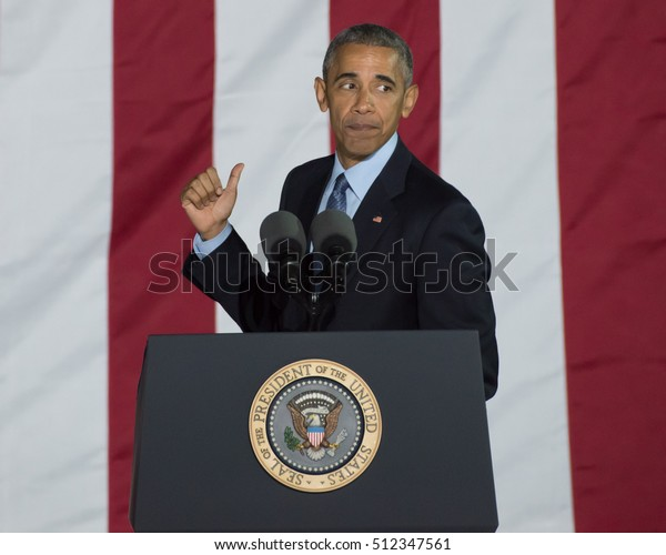 PHILADELPHIA, PA - NOVEMBER 7, 2016: Barack Obama gestures. The President of the United States delivers a speech at a campaign rally for Hillary Clinton the Democratic nominee for President.