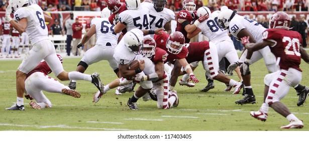 PHILADELPHIA, PA. - SEPTEMBER 17: Penn State running back Brandon Beachum (No. 3) looks for running room against Temple on September 17, 2011 at Lincoln Financial Field in Philadelphia, PA.