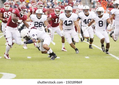 PHILADELPHIA, PA. - SEPTEMBER 17: Penn State defenders led by #2 Chaz Powell close in on Temple's Bernard Pierce on September 17, 2011 at Lincoln Financial Field in Philadelphia, PA.