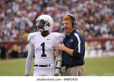 PHILADELPHIA, PA. - SEPTEMBER 17: Penn State Quarterback back Robert Bolden talks strategy with Coach McQueary against Temple on September 17, 2011 at Lincoln Financial Field in Philadelphia, PA.