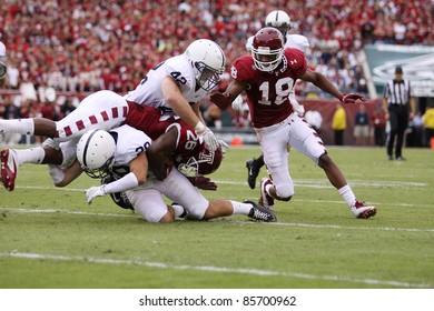 PHILADELPHIA, PA. - SEPTEMBER 17: Penn State defenders Michael Mauti  and Drew Astorino make a tackle against Temple on September 17, 2011 at Lincoln Financial Field in Philadelphia, PA.