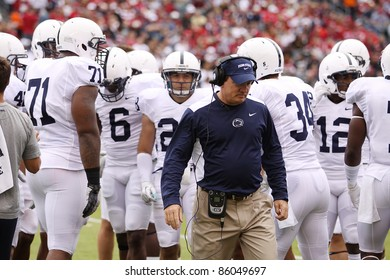 PHILADELPHIA, PA. - SEPTEMBER 17: Penn State Defensive Coordinator Tom Bradley walks back to the sideline  against Temple on September 17, 2011 at Lincoln Financial Field in Philadelphia, PA.