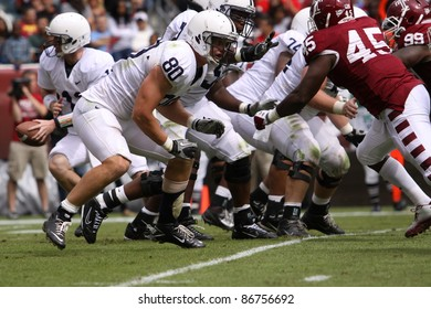 PHILADELPHIA, PA. - SEPTEMBER 17: Penn State quarterback Matthew McGloin moves to hand the football off in a game against Temple on September 17, 2011 at Lincoln Financial Field in Philadelphia, PA.