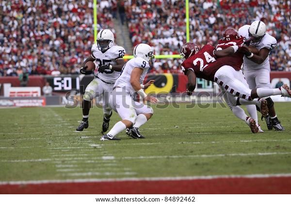 PHILADELPHIA, PA. - SEPTEMBER 17: Penn State running back Silas Redd heads for the end zone, #9 Michael Zorich blocks on September 17, 2011 at Lincoln Financial Field in Philadelphia, PA.