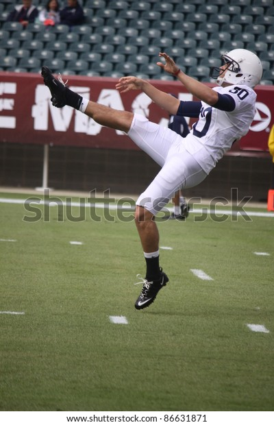 PHILADELPHIA, PA. - SEPTEMBER 17: Penn State punter #30 Anthony Fera follows through on a punt during agame with  Temple on September 17, 2011 at Lincoln Financial Field in Philadelphia, PA.