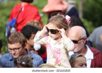 PHILADELPHIA, PA - SEPTEMBER 26 2015: Pope Francis celebrated mass at the Cathedral Basilica of Peter & Paul in downtown Philadelphia. Little girl tries on sunglasses