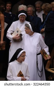 PHILADELPHIA, PA - SEPTEMBER 26 2015: Pope Francis arrived at the Cathedral Basilica of Peter and Paul in downtown Philadelphia to celebrate mass. Nuns emerge from Basilica after mass