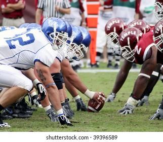 PHILADELPHIA, PA. - SEPTEMBER 26 : Buffalo Offensive Line to hike the football against Temple on September 26, 2009 in Philadelphia, PA.
