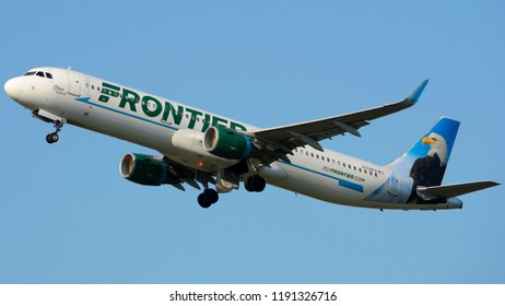 """Philadelphia, PA - September 29th, 2018: A Frontier Airlines Airbus A321-211, """"Steve the Eagle"""", Taking Off"""