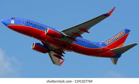 Philadelphia, PA - September 29th, 2018: A Southwest Airlines Boeing 737-7H4, with a Charles E. Taylor Sticker on the Nose, Taking Off