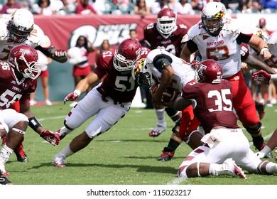 PHILADELPHIA, PA. - SEPTEMBER 8: Maryland running back #44 Justus Pickett looks for running room against Temple on September 8, 2012 at Lincoln Financial Field in Philadelphia, PA.