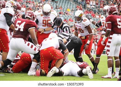 PHILADELPHIA, PA. - SEPTEMBER 8: Maryland and Temple players battle for the football after a fumble during a game on September 8, 2012 at Lincoln Financial Field in Philadelphia, PA.