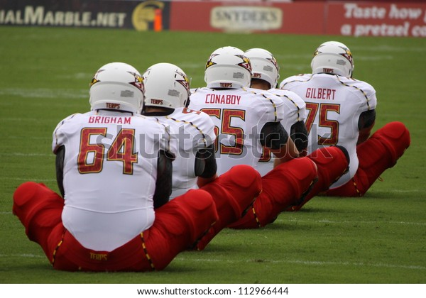PHILADELPHIA, PA. - SEPTEMBER 8: Maryland players stretch out in a row before a game against Temple on September 8, 2012 at Lincoln Financial Field in Philadelphia, PA.
