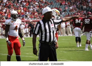 PHILADELPHIA, PA. - SEPTEMBER 8: The referee  signals a penalty against the defense during a game, Maryland against Temple on September 8, 2012 at Lincoln Financial Field in Philadelphia, PA.