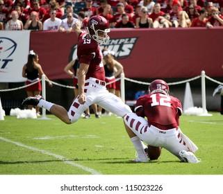 PHILADELPHIA, PA. - SEPTEMBER 8: Temple kicker Brandon McManus kicks an extra point against Maryland on September 8, 2012 at Lincoln Financial Field in Philadelphia, PA.