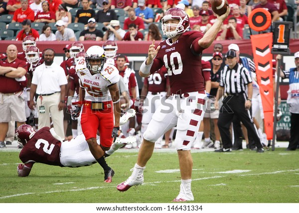 PHILADELPHIA, PA. - SEPTEMBER 8: Temple quarterback Chris Coyer looks for a receiver against Maryland on September 8, 2012 at Lincoln Financial Field in Philadelphia, PA.