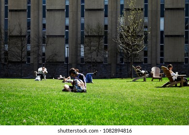Philadelphia, PA, USA - April 23, 2018: Students lounge on campus green space in Philadelphia's University City neighborhood.