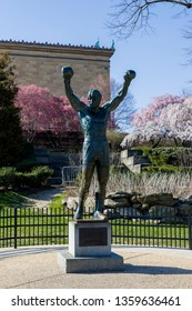 Philadelphia, PA / USA - April 3rd, 2019: Rocky Balboa Statue in front of the Philadelphia Art Museum. Statue from famous Rocky series movies in the city of brotherly love.