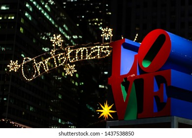 Philadelphia, PA USA - December 3 2018: Christmas Love Written with Christmas Lights and Love Park Statue