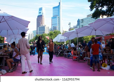 Philadelphia, PA USA - July 20, 2018: Crowds of people enjoy the food offerings and entertainment at The Oval+, a four-week summer event at Eakins Oval in Philadelphia, Pennsylvania.