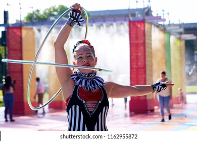 Philadelphia, PA USA - July 20, 2018: A circus performer entertains crowds at The Oval+, a four-week summer event at Eakins Oval in Philadelphia, Pennsylvania.