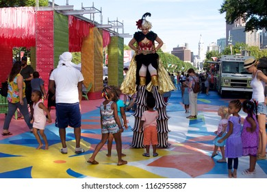 Philadelphia, PA USA - July 20, 2018: Crowds of people enjoy food offerings and entertainment at The Oval+, a four-week summer event at Eakins Oval in Philadelphia, Pennsylvania.