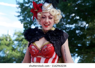 Philadelphia, PA USA - July 20, 2018: A cheerful stilt walker is one of the circus performers seen at The Oval+, a four-week summer event at Eakins Oval in Philadelphia, Pennsylvania.