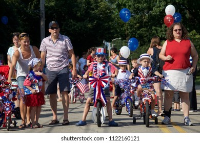 Philadelphia, PA, USA - July 4, 2012: Families celebrate America's Independence Day with the annual children's decorated bicycle parade in Philadelphia's Chestnut Hill neighborhood.