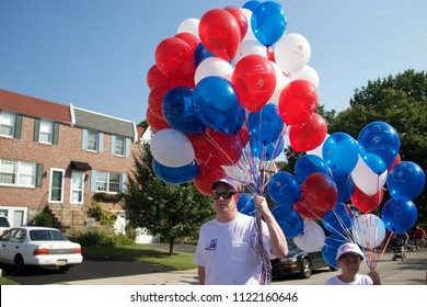 Philadelphia, PA, USA - July 4, 2012: Balloons are given out in celebration of America's Independence Day in Philadelphia's Chestnut Hill neighborhood.