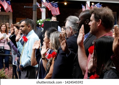 Philadelphia, PA / USA - June 14, 2019: Thirteen immigrants officially become new U.S. citizens in a special naturalization ceremony on Flag Day at the historic Betsy Ross House in Philadelphia,