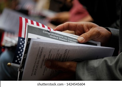 Philadelphia, PA / USA - June 14, 2019: Thirteen immigrants from 12 different countries become new U.S. citizens in a special naturalization ceremony on Flag Day at the historic Betsy Ross House.