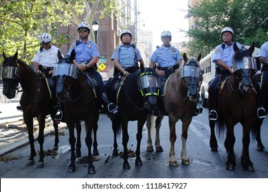 Philadelphia, PA, USA - June 19, 2018: Mounted police form a barricade as thousands protest the Trump Administration policy of separating immigrant children and their parents at the U.S.-Mexico border