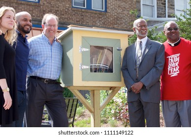 Philadelphia, PA, USA - June 7, 2018; State Senator Art Haywood (right) is joined by developer Ken Weinstein and community leaders for the dedication of a new pocket park and Little Free Library,