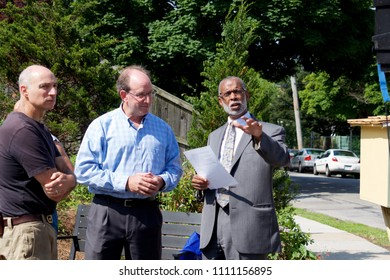 Philadelphia, PA, USA - June 7, 2018; Community developer Ken Weinstein and State Senator Art Haywood are joined by community leaders for the dedication of a new pocket park and Little Free Library.