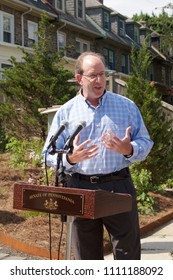 Philadelphia, PA, USA - June 7, 2018; Community developer Ken Weinstein speaks at a dedication of a new pocket park and Little Free Library, in the Mt Airy neighborhood of Philadelphia, PA.