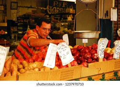 Philadelphia, PA, USA June 8, 2009 A Fruit Vendor Sets up his Produce Shop in Philadelphia's Italian Market