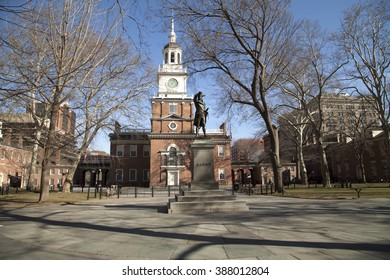 Philadelphia, Pa. USA, March 5, 2016: Independence Hall tower and statue of Commodore Barry in Philadelphia. March 5, 2016 in Philadelphia, Pa. USA.