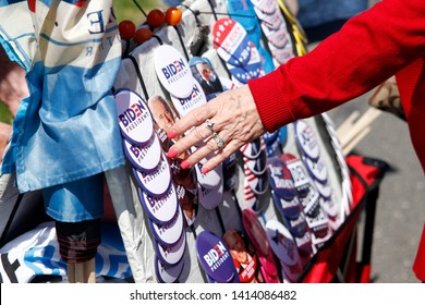 Philadelphia, PA / USA - May 18, 2019: An elderly upper middle class woman selects a political button ahead of Joe Biden's campaign rally for the 2020 United States presidential election.