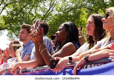 Philadelphia, PA / USA - May 18, 2019: A diverse group of young supporters listen to former Vice President Joe Biden as he kicks off his 2020 campaign for the US presidential election at a rally.