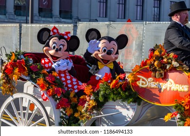 Philadelphia, PA, USA - November 26, 2015: Mickey and Minnie Mouse ride in an open carriage in the annual Thanksgiving Day parade.