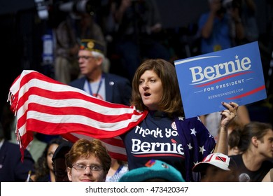 Philadelphia, PA/USA July 25, 2016: Bernie Sanders supporter stands in protest during the first day of the Democratic National Convention.