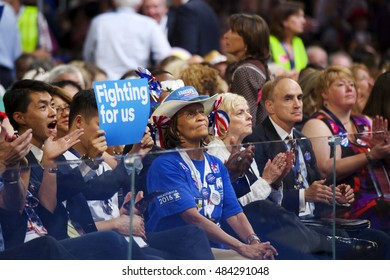 Philadelphia, PA/USA - July 25, 2016:  Delegates listen and react to a speech at the Democratic National Convention.