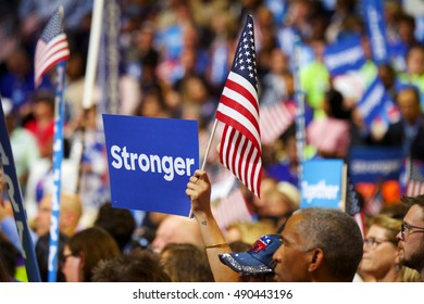 Philadelphia, PA/USA July 25, 2016: DNC Convention supporters hold up election signs and the American flag.