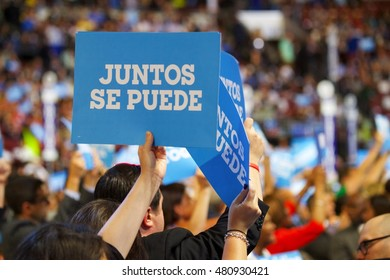 """Philadelphia, PA/USA July 27, 2016: DNC attendees hold up signage that read """"Juntos Se Puede"""""""